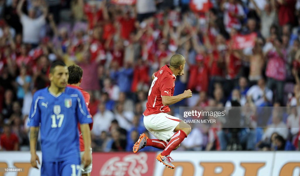 Switzerland's midfielder Gokhan Inler (R) jubilates after scoring against Italy during the WC2010 friendly football match Switzerland vs Italy at Geneva's stadium on June 5, 2010 ahead of the FIFA 2010 World Cup held in South Africa.