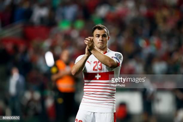 Switzerland's midfielder Xherdan Shaqiri applauds the supporters at the end of the FIFA World Cup WC 2018 football qualifier match between Portugal...