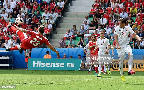 TOPSHOT Switzerland's midfielder Xherdan Shaqiri scores a goal during the Euro 2016 round of sixteen football match between Switzerland and Poland at...