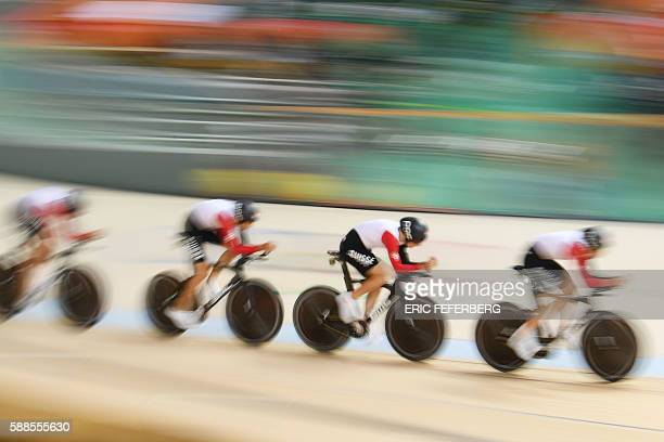 Switzerland's Olivier Beer Switzerland's Silvan Dillier Switzerland's Thery Schir and Switzerland's Cyrille Thiery compete in the men's Team Pursuit...