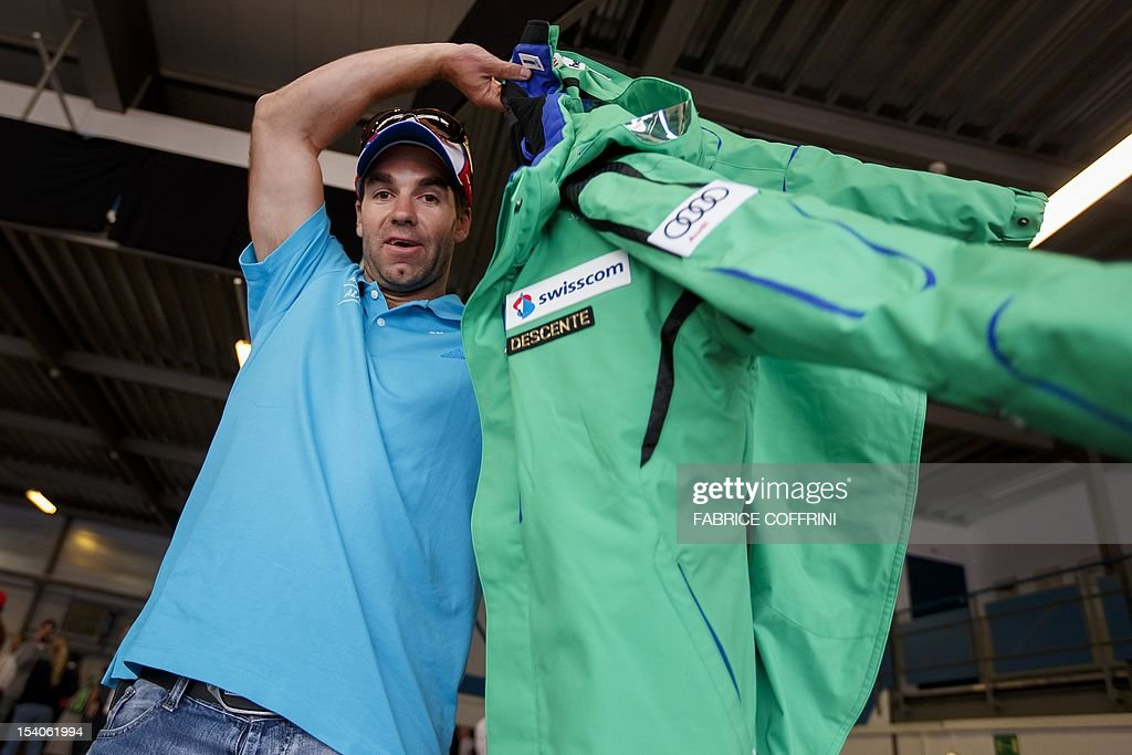 Switzerland's Olympic champion Didier Defago wears his new team jacket during the traditional delivery of materials of the Swiss Alpine ski team on October 13, 2012 in Duebendorf near Zurich. The season 2012-2013 of the FIS Alpine Ski World cup starts on October 27, 2012 in Solden.