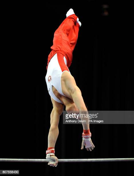 Switzerland's Pablo Braegger competes on the High Bar during the Junior Qualification of the European Gymnastics Championships at the National Indoor...