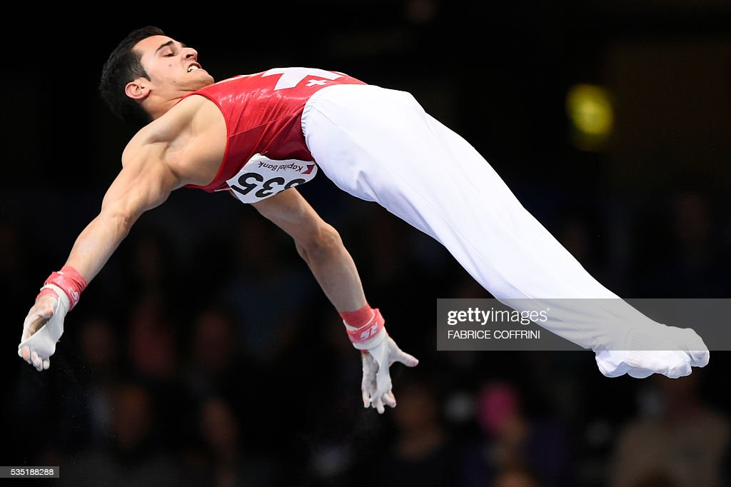 Switzerlands Pablo Braegger performs during the Mens Horizontal Bar competition of the European Artistic Gymnastics Championships 2016 in Bern, Switzerland on May 29, 2016. / AFP / FABRICE