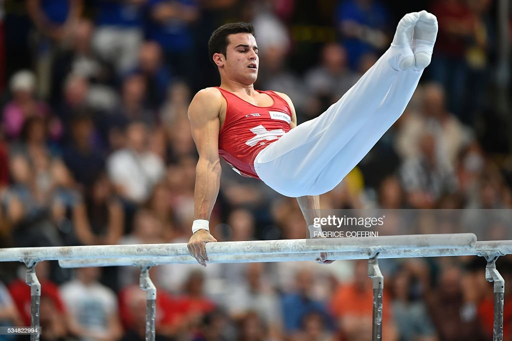 Switzerland's Pablo Braegger performs during the Mens Parallel Bars competition of the European Artistic Gymnastics Championships 2016 in Bern, Switzerland on May 28, 2016. / AFP / FABRICE