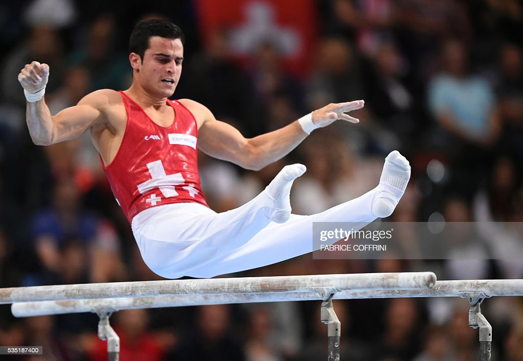 Switzerlands Pablo Braegger performs during the Mens Parallel Bars competition of the European Artistic Gymnastics Championships 2016 in Bern, Switzerland on May 29, 2016. / AFP / FABRICE