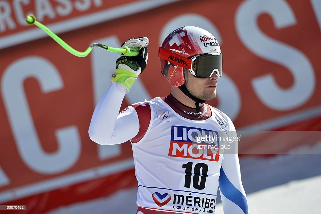 Switzerland's Patrick Kueng reacts after the Men's downhill at the FIS Alpine Skiing World Cup finals in Meribel on March 18, 2015. AFP PHOTO / JEFF PACHOUD