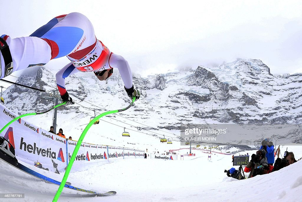 Switzerland's Patrick Kueng takes the start of the FIS Alpine World Cup Men's Downhill training on January 15 2014 in Wengen AFP PHOTO / OLIVIER MORIN