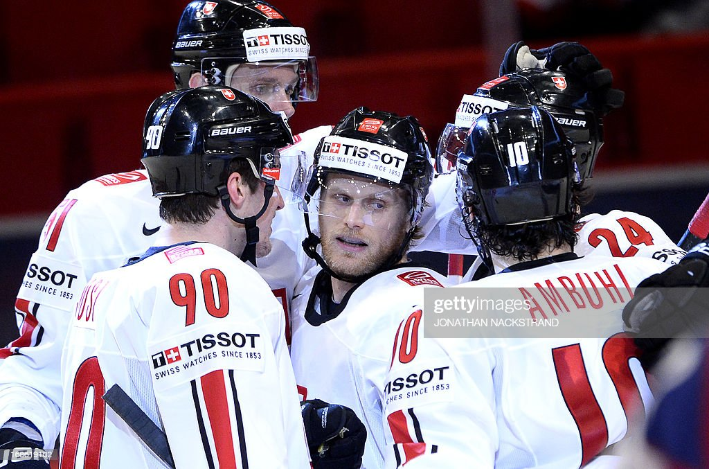 Switzerland's Patrick von Gunten (C) celebrates with his teammates after scoring during the preliminary round match Norway vs Switzerland at the 2013 IIHF Ice Hockey World Championships on May 12, 2013 in Stockholm.
