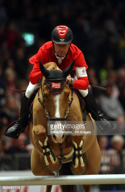 Switzerland's Pius Schwizer rides Joy's Mouch 909 in the Martin Collins Eraser Stakes during the London International Horse Show at the Olympia...