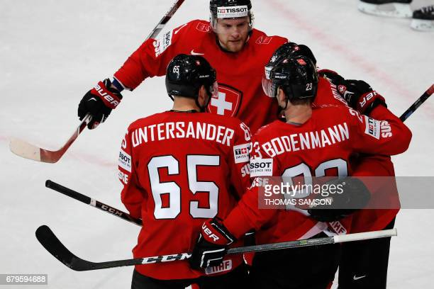 Switzerland's players celebrate after they scored during the IIHF Men's World Championship group B ice hockey match between Switzerland and Slovenia...