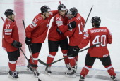 Switzerland's players celebrate the scoring of a goal during a IIHF International Ice Hockey World Championship preliminary round group B game...