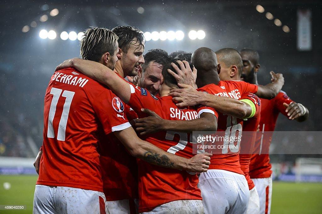 Switzerland's players celebrates after midfielder Xherdan Shaqiri scored the team's third goal during an Euro 2016 Group E qualifying match...