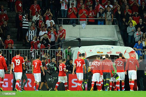 Switzerland's players leave the pitch at the end of the FIFA World Cup 2014 qualifying football match Switzerland vs Iceland at the Stade de Suisse...