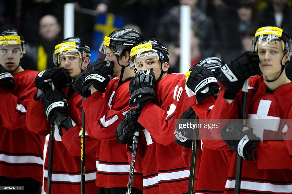 Switzerland's players react after losing the Group B preliminary round match Switzerland vs Sweden at the IIHF World Junior Ice Hockey Championships in Malmoe, Sweden on December 26, 2013. Sweden won 5-3 against Switzerland.