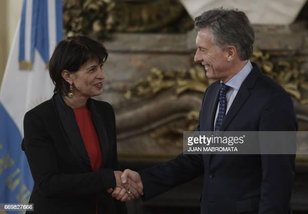 Switzerland's President Doris Leuthard and Argentina's President Mauricio Macri shake hands before a working meeting at the Casa Rosada presidential...
