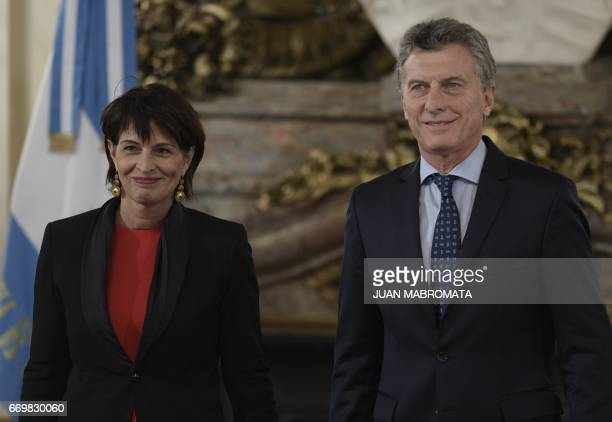 Switzerland's President Doris Leuthard and Argentina's President Mauricio Macri pose for pictures before holding a working meeting at the Casa Rosada...