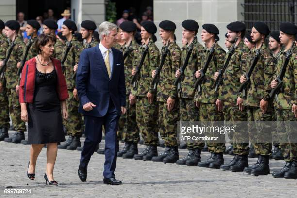 Switzerland's President Doris Leuthard and Belgium's King Philippe review an honour guard on June 22 2017 in Bern Belgium's King Philippe is on a...