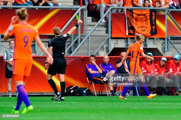Switzerland's referee Esther Staubli gives a yellow card to Netherlands' midfielder Jackie Groenen during the UEFA Womens Euro 2017 football...