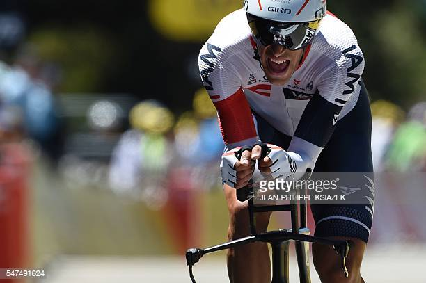 Switzerland's Reto Hollenstein crosses the finish line of the 375 km individual timetrial the thirteenth stage of the 103rd edition of the Tour de...
