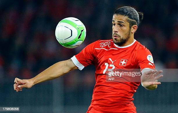 Switzerland's Ricardo Rodriguez eyes the ball during the FIFA World Cup 2014 qualifying football match Switzerland vs Iceland at the Stade de Suisse...