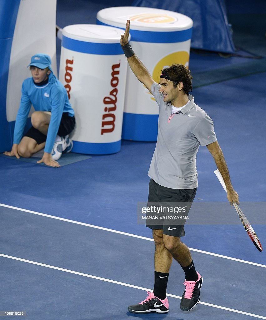 Switzerland's Roger Federer acknowledges the crowd after beating Canada's Milos Raonic during their men's singles match on day eight of the Australian Open tennis tournament in Melbourne on January 21, 2013.