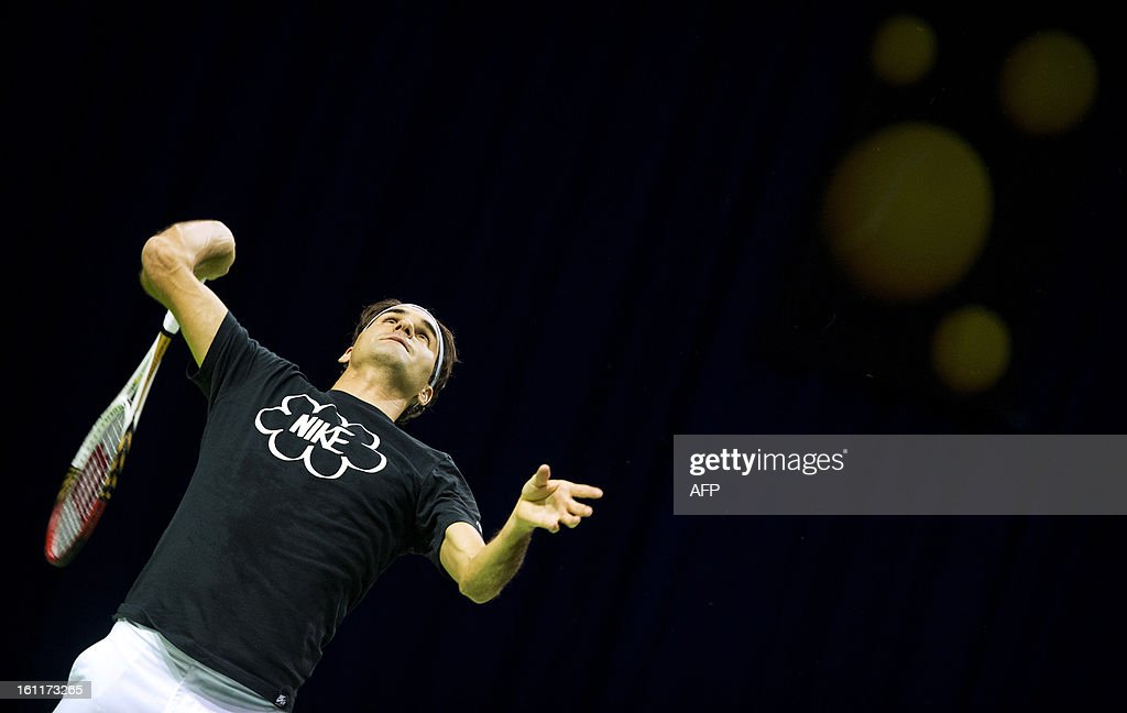 Switzerland's Roger Federer aims a shot during a training session for the ABN AMRO tennis tournament in Rotterdam on February 9, 2013. The tournament will take place from February 11 to 17. AFP PHOTO / ANP / KOEN VAN WEEL netherlands out