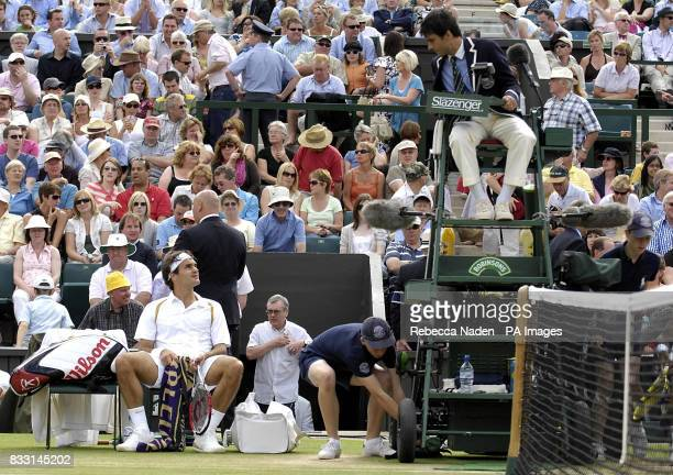 Switzerland's Roger Federer argues with the umpire following a Hawk Eye decision against him in his match against Spain's Rafael Nadal during The All...