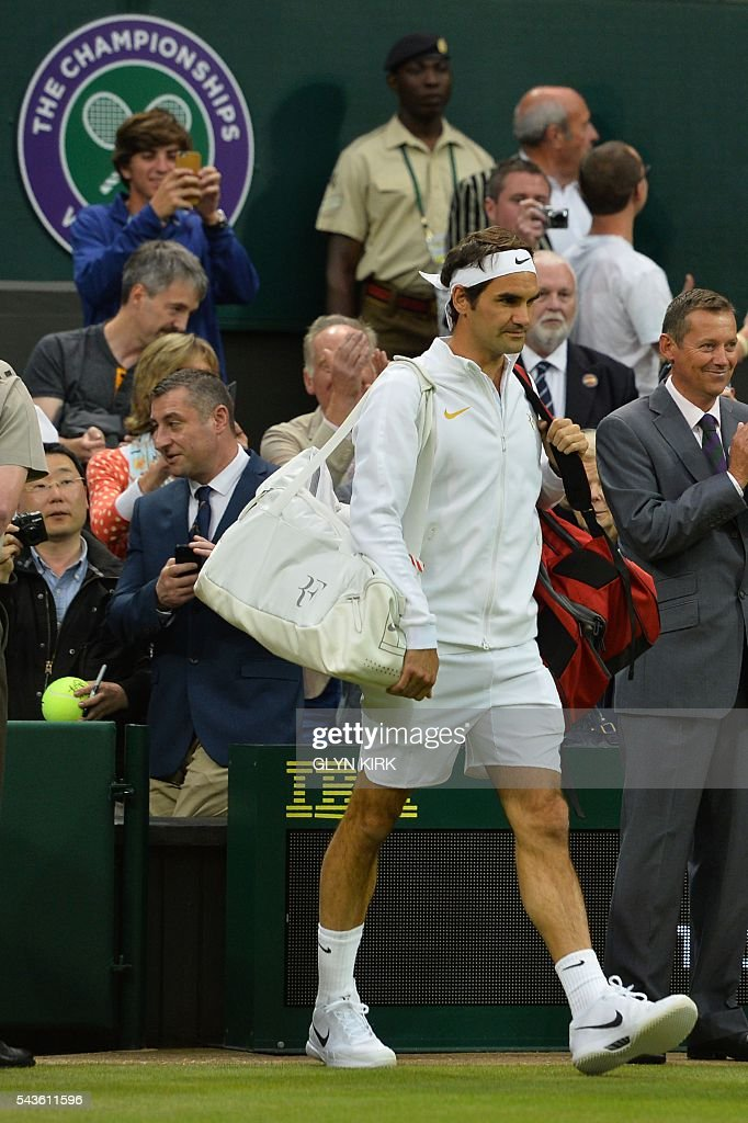Switzerland's Roger Federer arrives on court to play Britain's Marcus Willis in their men's singles second round match on the third day of the 2016 Wimbledon Championships at The All England Lawn Tennis Club in Wimbledon, southwest London, on June 29, 2016. / AFP / GLYN