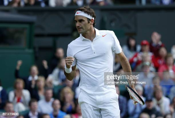 Switzerland's Roger Federer celebrates a point against Ukraine's Sergiy Stakhovsky during day Three of the Wimbledon Championships at The All England...