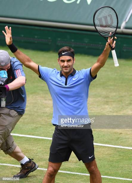 Switzerland's Roger Federer celebrates after winning against Germany's Mischa Zverev during the ATP tennis tournament in Halle western Germany on...