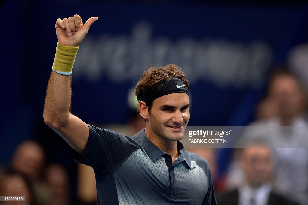 Switzerland's Roger Federer celebrates after winning his match against Uzbekistan's Denis Istomin on October 23, 2013 at the Swiss Indoors tennis tournament in Basel. Federer stormed back after a slow start to turn the tables on Denis Istomin for a 4-6, 6-3, 6-2 second round win at the Swiss Indoors.