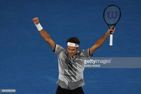 TOPSHOT Switzerland's Roger Federer celebrates beating Germany's Mischa Zverev in their men's singles quarterfinal match on day nine of the...