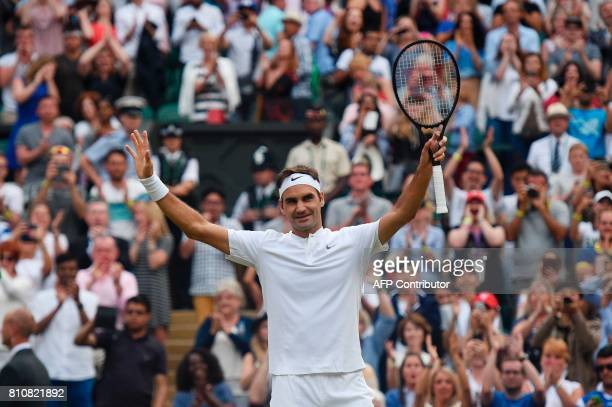 Switzerland's Roger Federer celebrates beating Germany's Mischa Zverev during their men's singles third round match on the sixth day of the 2017...