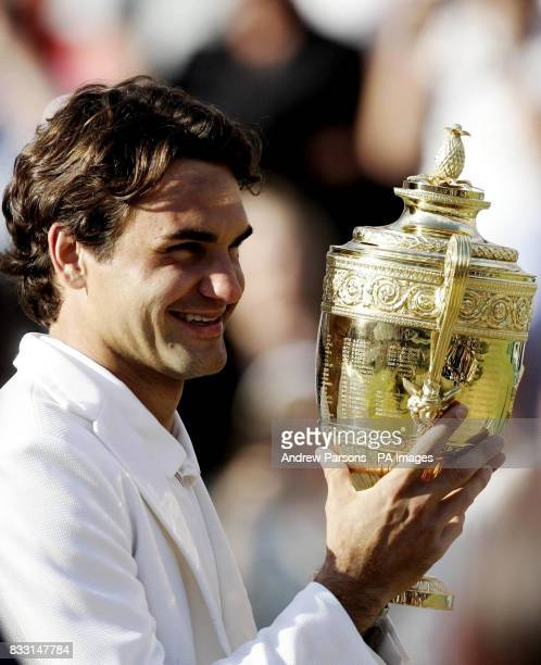 Switzerland's Roger Federer celebrates his fifth successive Wimbledon Championship victory after beating Spain's Rafael Nadal in five sets 76 46 76...