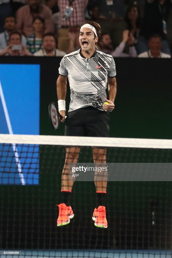 Switzerland's Roger Federer celebrates his victory against Spain's Rafael Nadal during the men's singles final on day 14 of the Australian Open tennis tournament in Melbourne on January 29, 2017. / AFP / POOL / Scott BARBOUR / IMAGE
