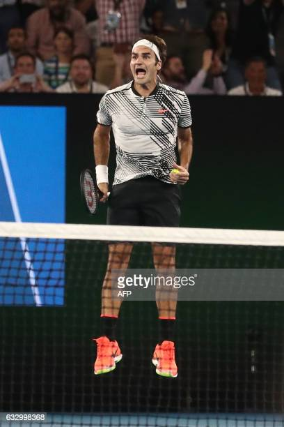 Switzerland's Roger Federer celebrates his victory against Spain's Rafael Nadal during the men's singles final on day 14 of the Australian Open...