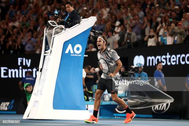 TOPSHOT Switzerland's Roger Federer celebrates his victory against Spain's Rafael Nadal during the men's singles final on day 14 of the Australian...
