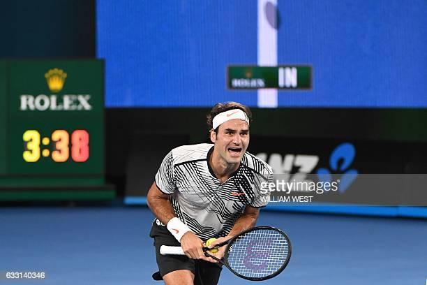 Switzerland's Roger Federer celebrates his victory against Spain's Rafael Nadal during the men's singles final on day 14 of the Australian Open...