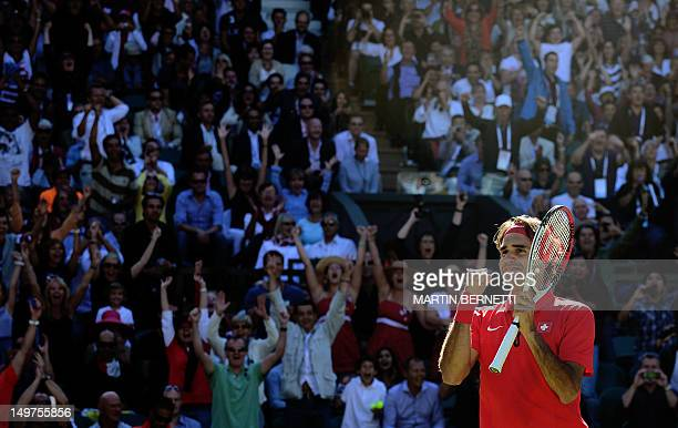 Switzerland's Roger Federer celebrates victory over Argentina's Juan Martin del Potro in the men's singles semifinal round match at the 2012 London...