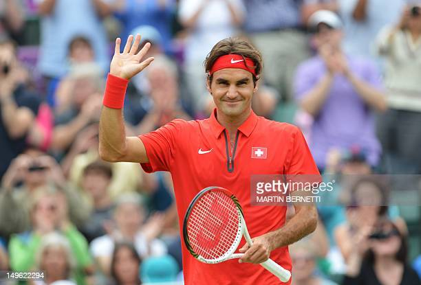 Switzerland's Roger Federer celebrates victory over Uzbekistan's Denis Istomin during their men's singles tennis match third round in the 2012 London...