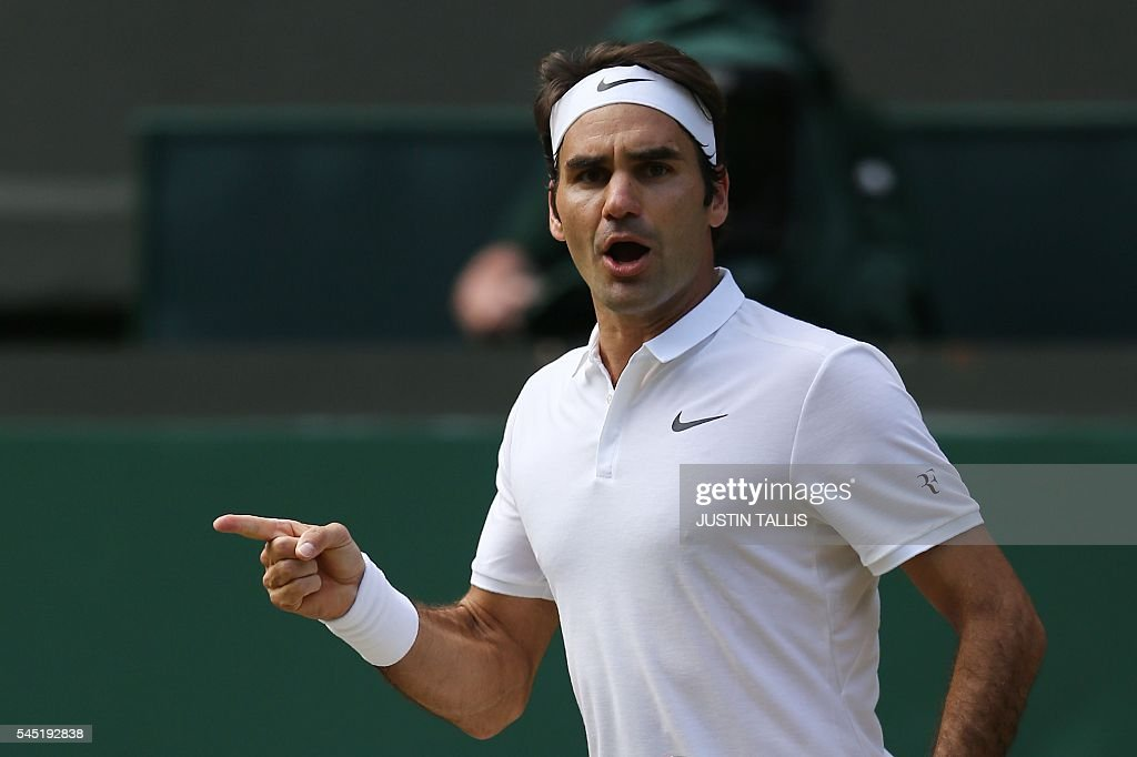 Switzerland's Roger Federer celebrates winning the tiebreaker to take the fourth set against Croatia's Marin Cilic during their men's singles...