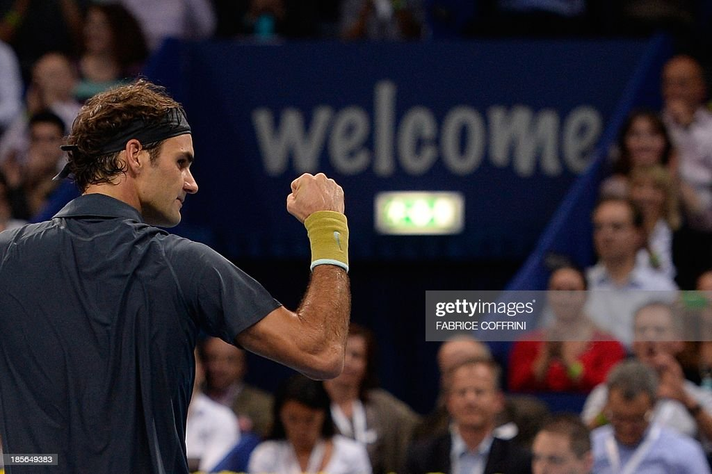 Switzerland's Roger Federer celelbrates after winning his match against Uzbekistan's Denis Istomin on October 23, 2013 at the Swiss Indoors tennis tournament in Basel.