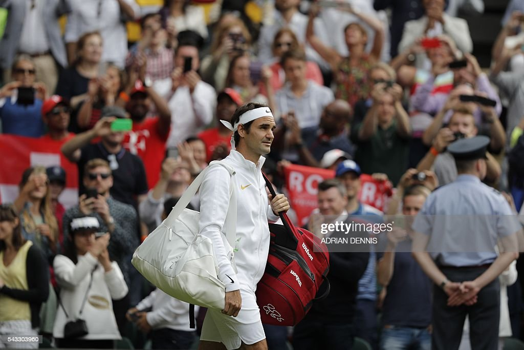Switzerland's Roger Federer comes onto Centre Court to play against Argentina's Guido Pella during their men's singles first round match on the first day of the 2016 Wimbledon Championships at The All England Lawn Tennis Club in Wimbledon, southwest London, on June 27, 2016. / AFP / ADRIAN