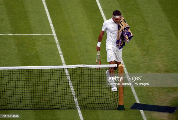 Switzerland's Roger Federer during a change of ends during his match against Ukraine's Sergiy Stakhovsky during day Three of the Wimbledon...