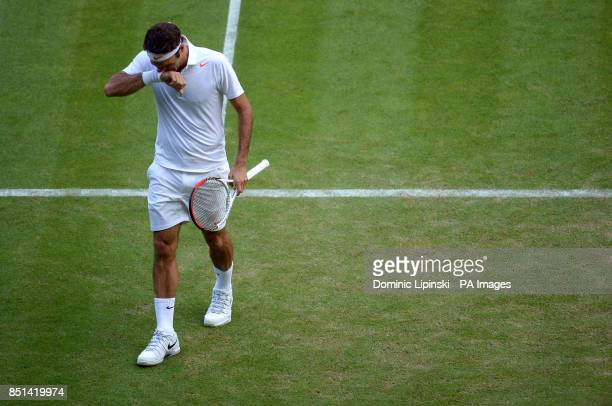 Switzerland's Roger Federer during his match against Ukraine's Sergiy Stakhovsky during day Three of the Wimbledon Championships at The All England...