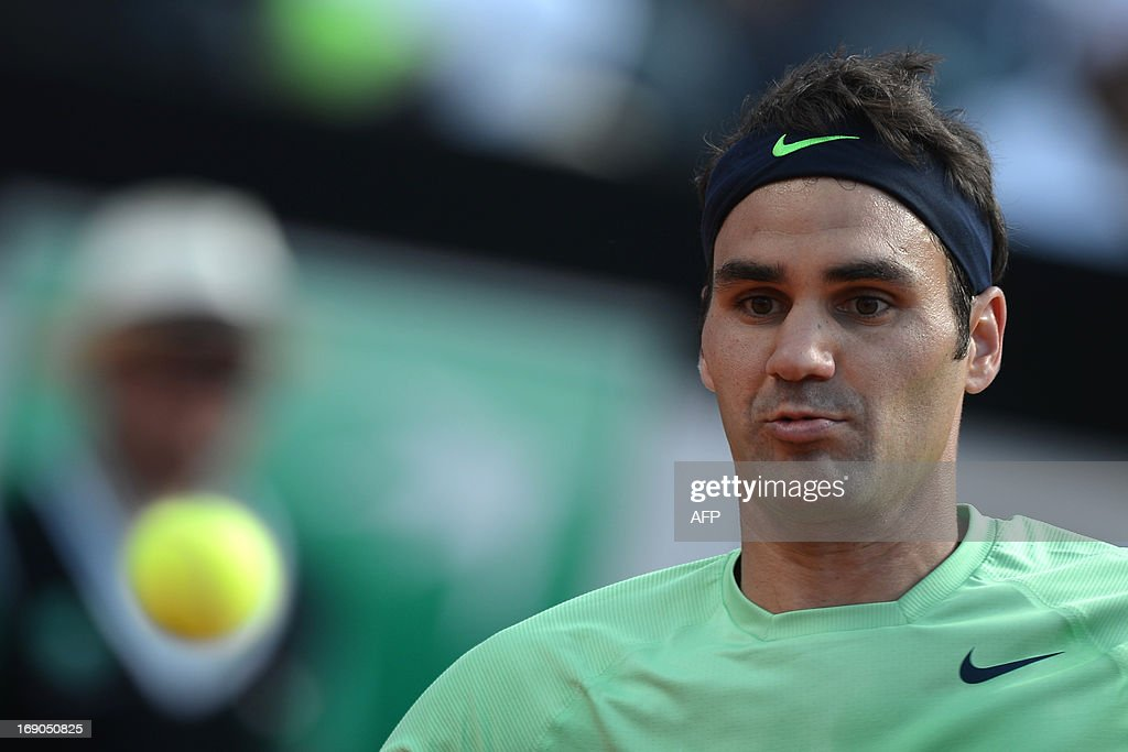 Switzerland's Roger Federer eyes a ball during the final of the ATP Rome Masters against Spain's Rafael Nadal on May 19, 2013.