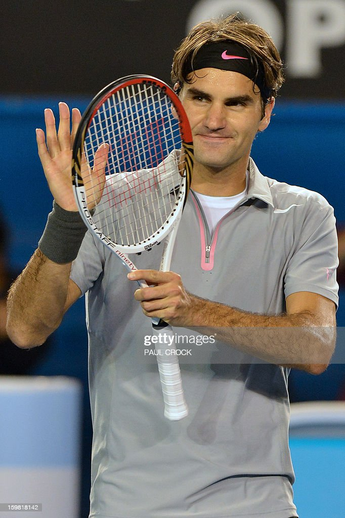 Switzerland's Roger Federer gestures after victory in his men's singles match against Canada's Milos Raonic on the eighth day of the Australian Open tennis tournament in Melbourne on January 21, 2013. AFP PHOTO/ PAUL CROCK IMAGE STRICTLY RESTRICTED TO EDITORIAL USE - STRICTLY NO COMMERCIAL USE