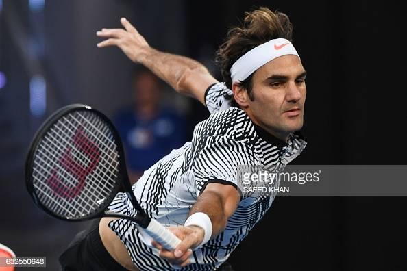 TOPSHOT Switzerland's Roger Federer hits a return against Germany's Mischa Zverev during their men's singles quarterfinal match on day nine of the...