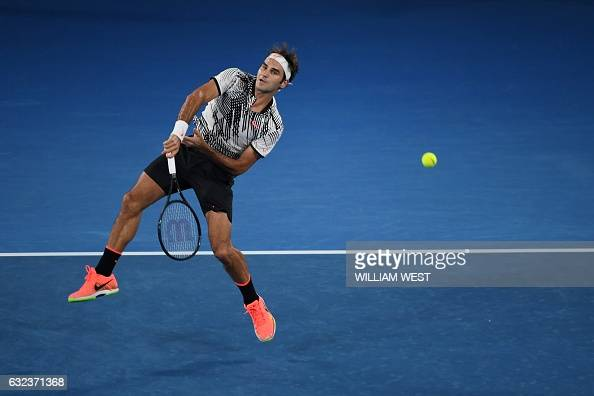 TOPSHOT Switzerland's Roger Federer hits a return against Japan's Kei Nishikori during their men's singles fourth round match on day seven of the...