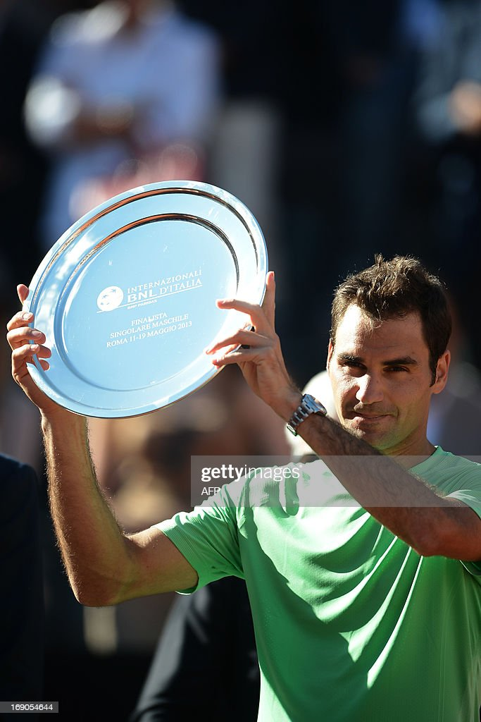 Switzerland's Roger Federer holds the trophy of second placed after the final of the ATP Rome Masters against Spain's Rafael Nadal on May 19, 2013. Nadal defeated Federer to win the title.